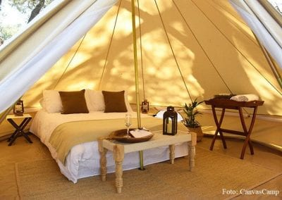 Large tent with bed and table