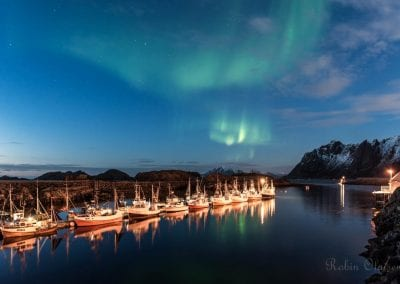 Northern lights over a marina