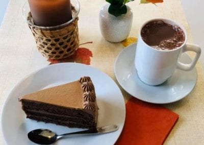 A plate with cake, and a cup of coffee
