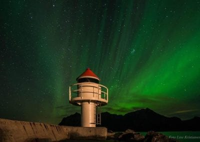 Picture of a lighthouse under the northern lights