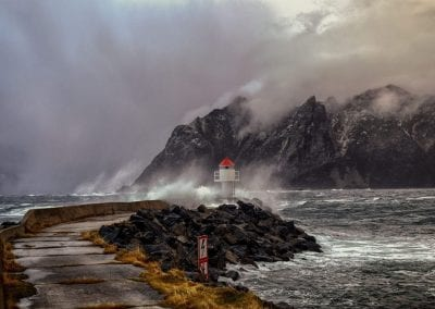 Storm at sea and waves hitting the lighthouse